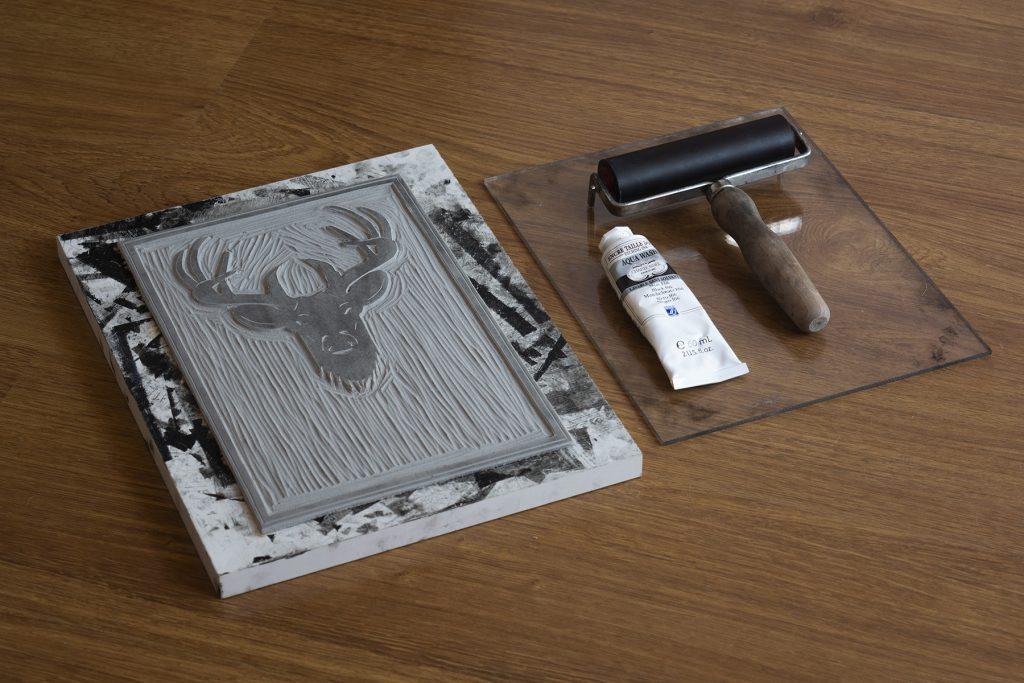 Linocut deer carving